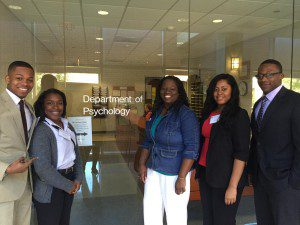 Grambling students and faculty in front of psych door